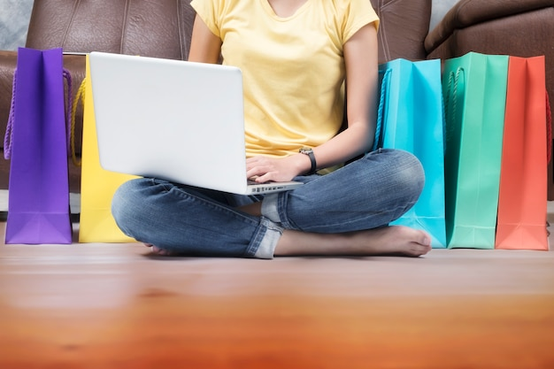 Laptop excited adult buying home sitting