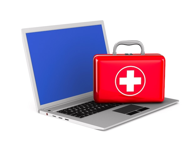 Laptop and first aid on white.