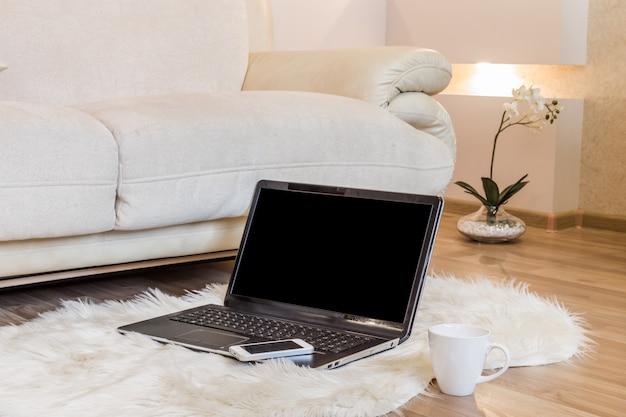 Laptop on a floor