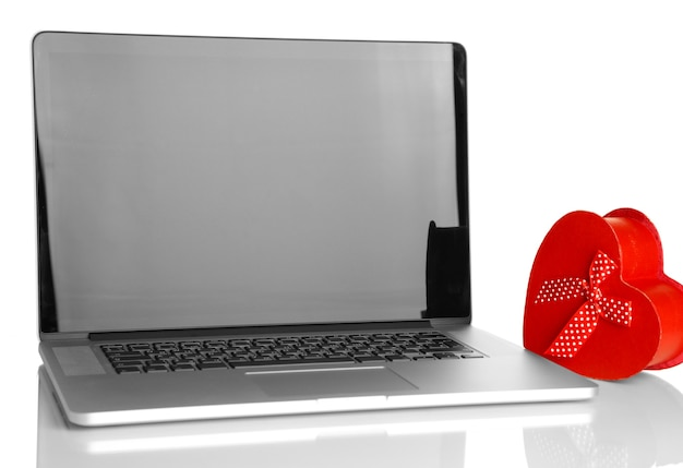 Laptop and gift isolated on white