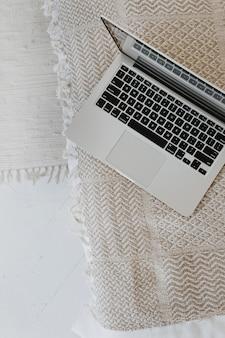 Laptop keyboard on wicker bench