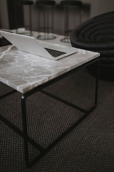 A laptop on a marble table