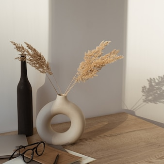 Laptop, notebook, glasses, pampas grass in vase