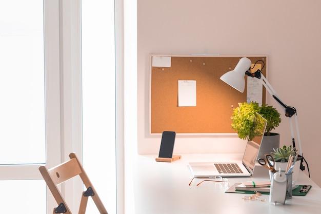 Laptop on office desk interior. stylish workplace mockup.
