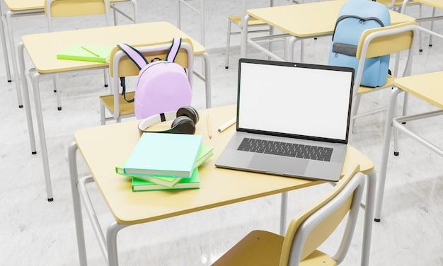 Ноутбук на школьной партой в классе с книгами и принадлежностями вокруг