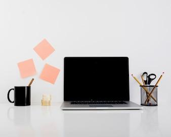 Laptop on reflective desk in office