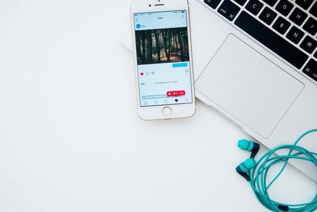 Laptop, phone, earphones and instagram