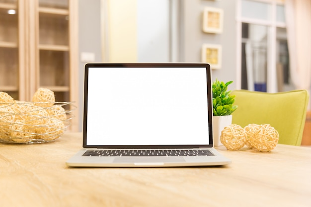 Laptop showing blank screen on work table front view in home