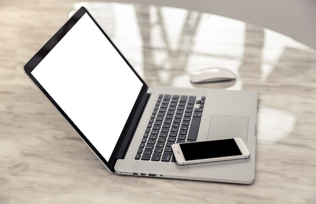 Laptop side with a smartphone