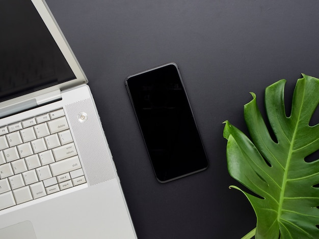 Laptop and smartphones on office desk.