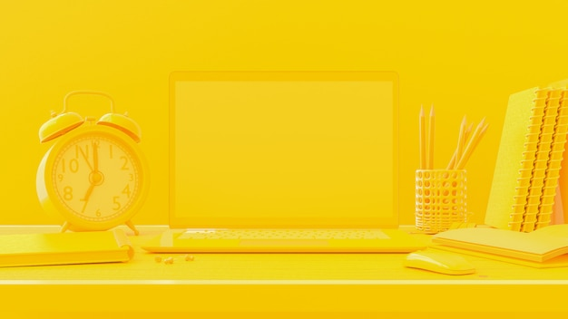 Laptop on table work desk yellow color background.