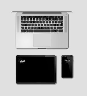 Модель-макет компьтер-книжки, таблетки и телефона изолированный на сером цвете. 3d визуализация