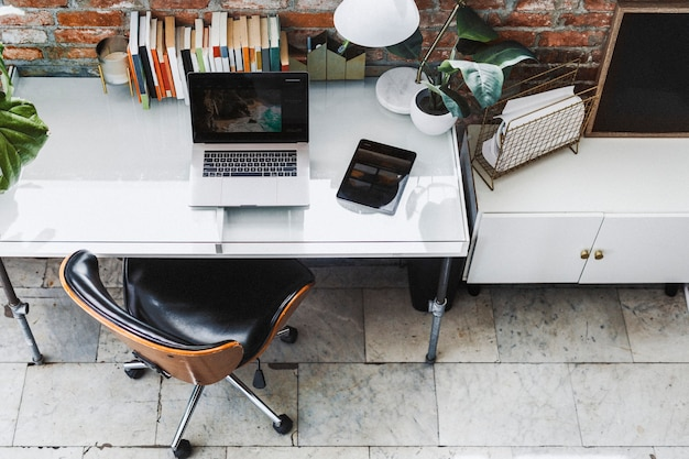 Laptop and a tablet in a home office