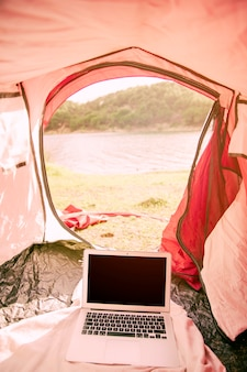 Laptop in tent on beach
