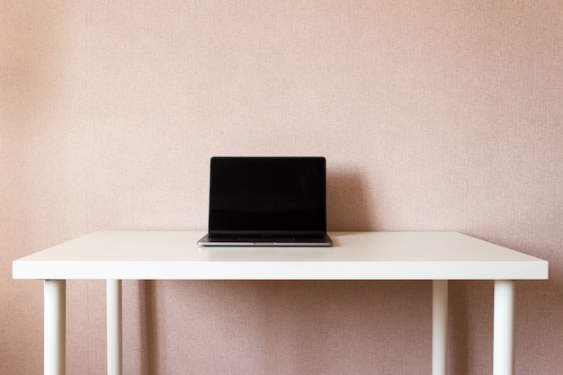Laptop on white table, workspace