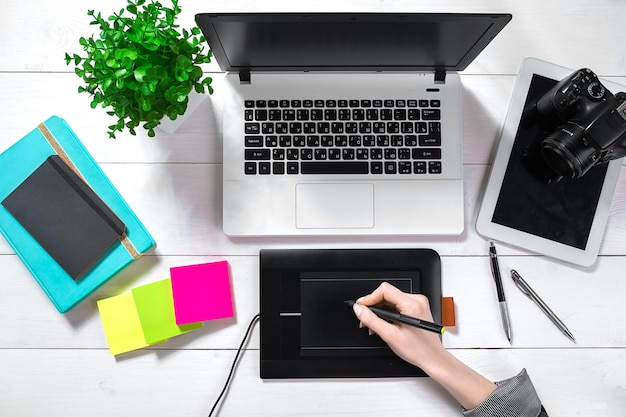 Laptop with blank screen and girls hands flat lay top view workspace