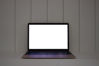 Laptop with blank screen on wood