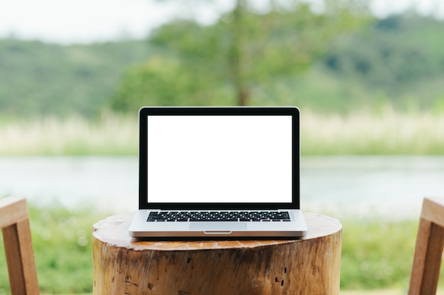 Laptop with blank screen on the terrace