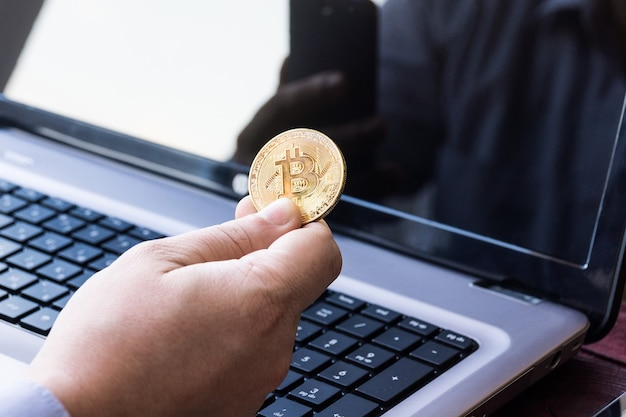 Laptop with cash and bitcoin