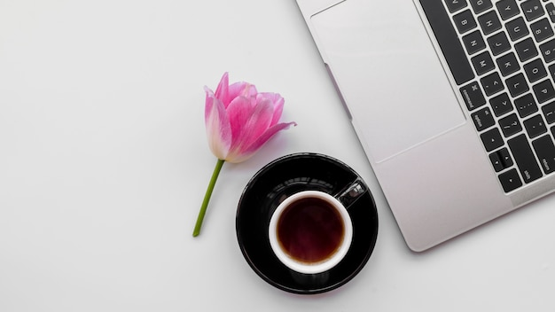 Laptop with flowers and coffee cup