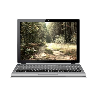 Laptop with forest road on screen