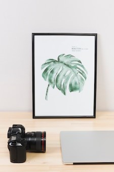 Laptop with picture and camera on light table