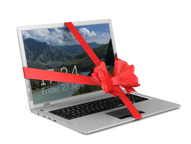 Laptop with red bow on white. isolated 3d illustration