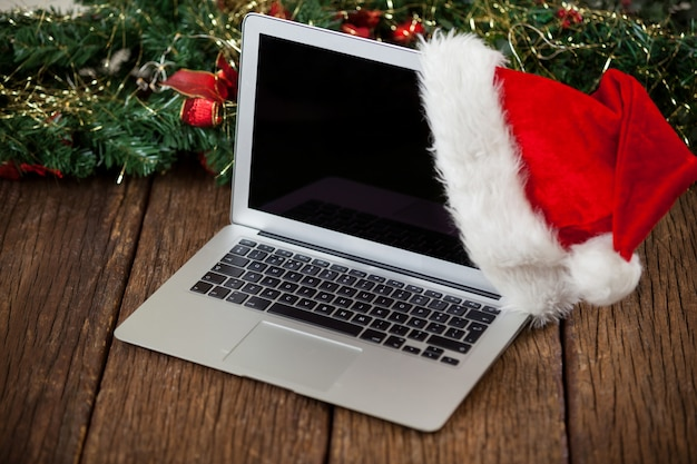 Laptop with a santa hat
