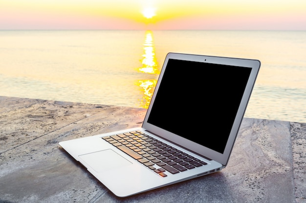 Laptop with sun background