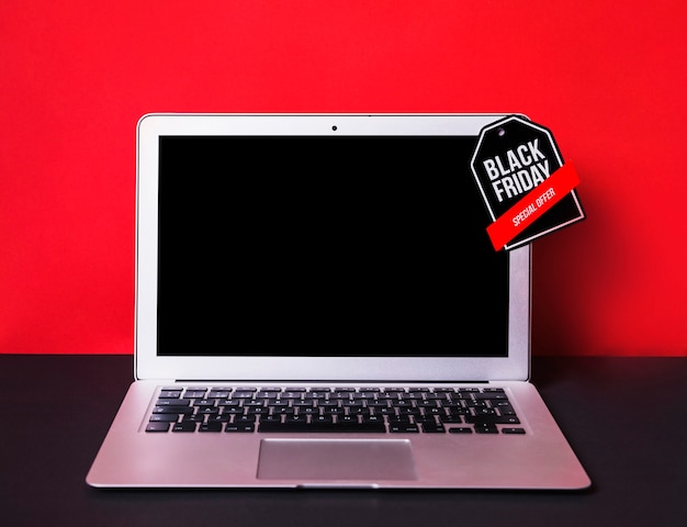 Laptop with toy sign
