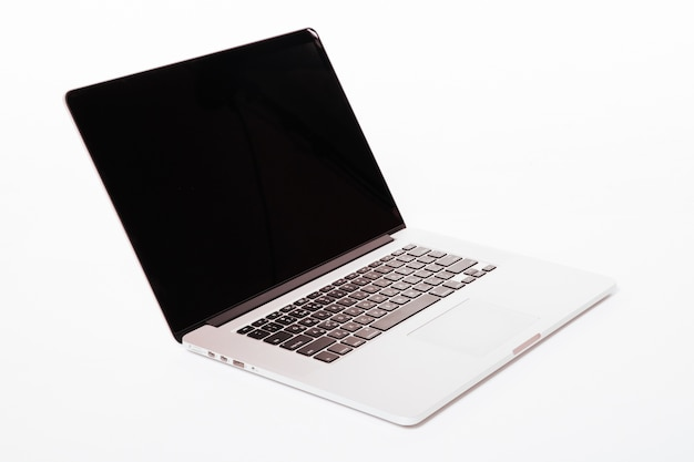 Laptop with white screen. isolated on white wall