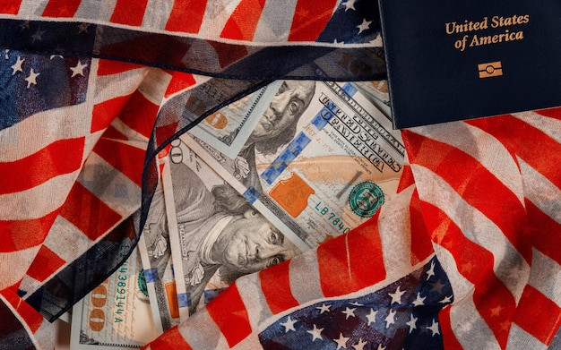 A large amount of 100 us dollar money of american passports in the national symbol of the usa flag