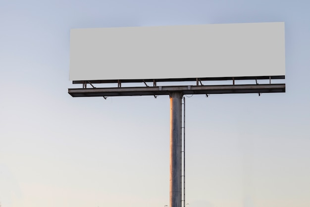 Large billboard advertising display against blue clear sky