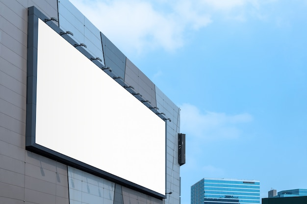 Large billboard on modern building wall