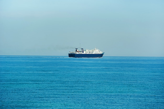 A large blue ferry for the transport of goods and people goes on the mediterranean sea