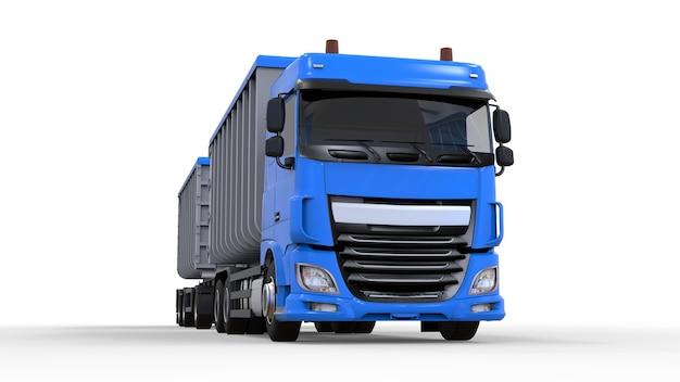 Большой синий грузовик с отдельным прицепом для перевозки сельскохозяйственных и строительных сыпучих материалов и продуктов.