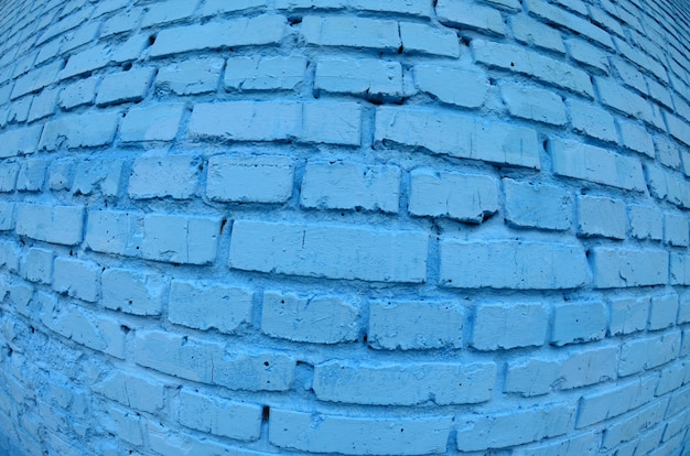 Large brick wall, painted in blue. fisheye photo with pronounced distortion