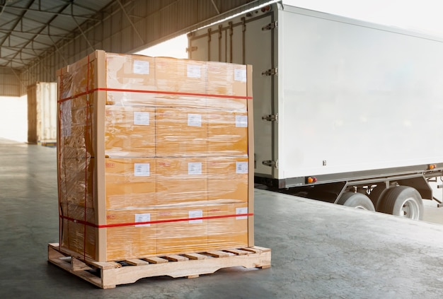 Large cargo pallet boxes waiting to load into cargo container