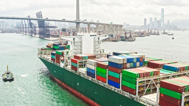 Large cargo ship transporting shipment container arriving hong kong port