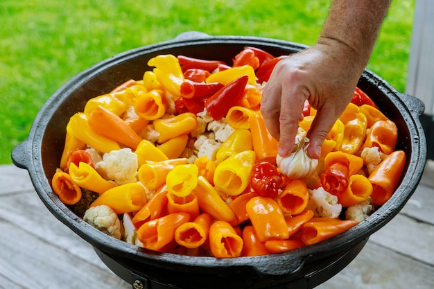 A large cauldron with a fresh healthy vegetable for party outdoor.