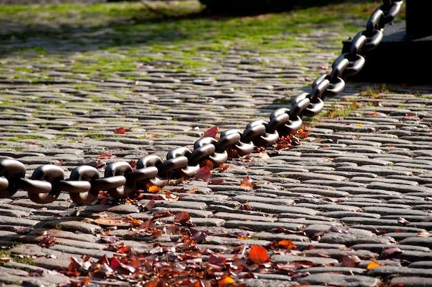 Large chain across cobblestone walkway in boston, massachusetts, usa