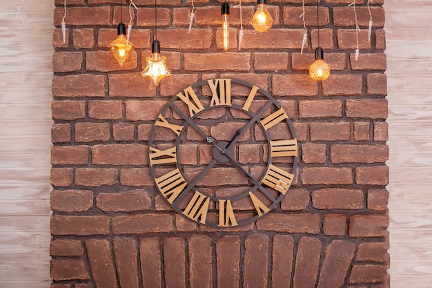 Large classic clock with roman numerals on a brick wall