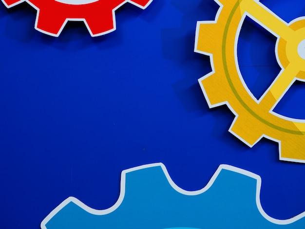Large cog wheels engine gear wheels blue background, industrial background