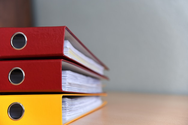 Large color folders for documents on the table in the office, close-up, copy space