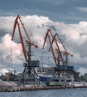 Large cranes in the city port by the sea
