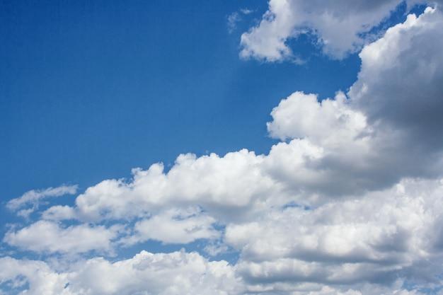 Large cumulus clouds in a blue sky