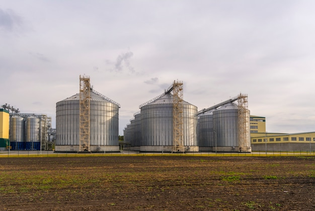 A large factory for the processing of grain. large elevator in the field.