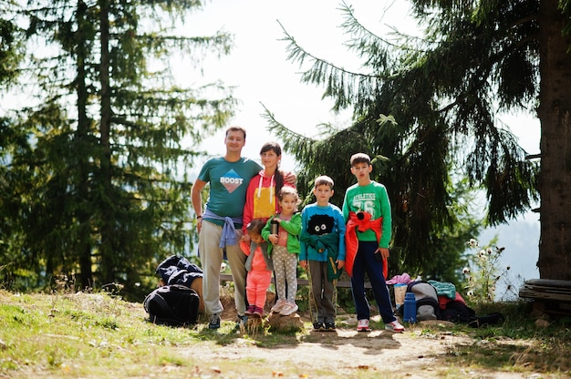 Large family with four kids resting in mountains. travel and hiking with childrens.