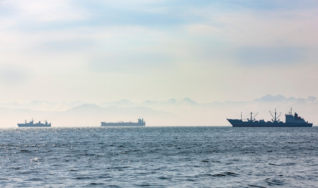 Large fishing vessel on of hills and volcanoes Premium Photo