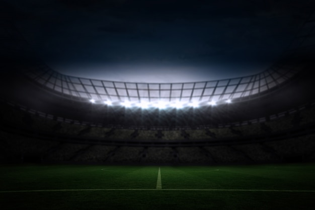 Large football stadium under night sky